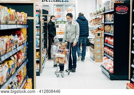 Budva, Montenegro - 17 March 2021: A Child With A Small Trolley In The Supermarket, Go Shopping With
