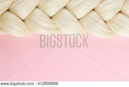 Smooth White Beautiful Pigtail. The Braid Is Braided By A Blonde On A Pink Background. The Concept O