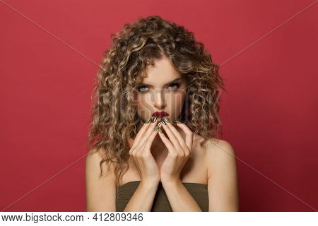 Nice Woman With Healthy Curly Hair On Red Background Portrait. Pretty Model With Trendy Hair Styling