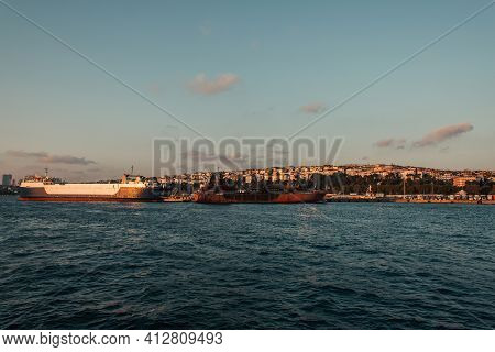 Ships Near Seafront And Istanbul City During Sunset, Turkey.