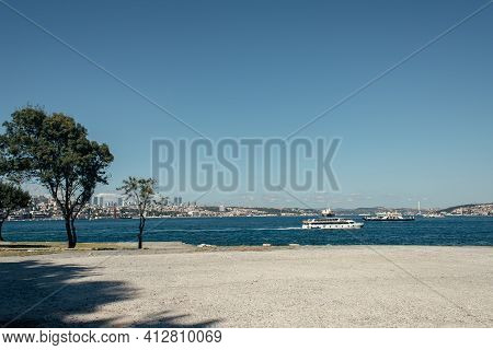 Trees On Seafront And Ships On Water In Istanbul, Turkey.