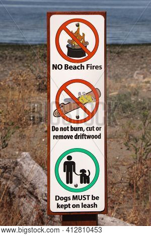 View Of Warning Sign No Beach Fires, Do Not Burn, Cut Or Remove Driftwood, Dogs Must Be Kept On Leas
