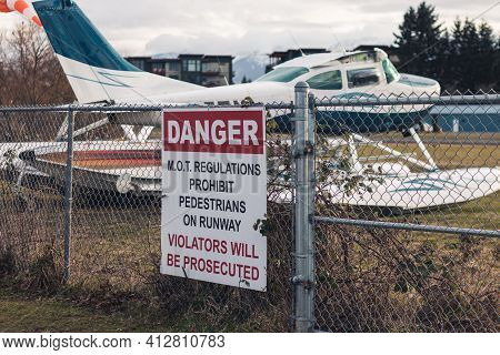 View Of Warning Sign Ministry Of Transportation Regulation Prohibit Pedestrian On Runway With Float