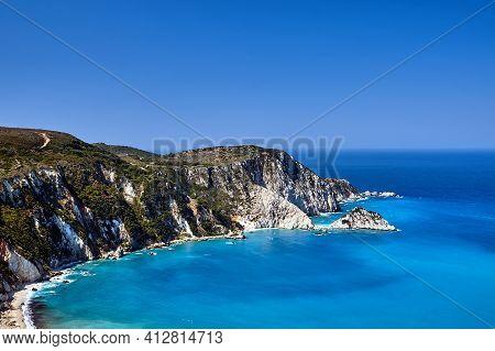 Rocky Coast At Petani Bay On The Island Of Kefalonia In Greece