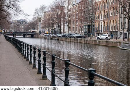 Daily Life Of Amsterdam, Street Parking In Old Part Of The City On Canal