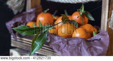 Fresh Tangerines Lies On A Black Background. There Is A Basket Of Tangerines.