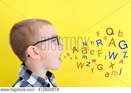 Speech Therapy. Toddler Boy Says Open Mouth With Letters. Classes With A Speech Therapist. Boy On Is