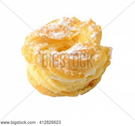 Sweet Baked Pastry In The Shape Of Wreath With Vanilla Whipped Cream And Sprinkled With Sugar, Isola
