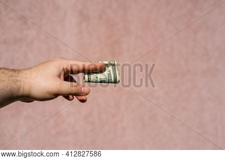 Hand Holding Showing Dollars Money And Giving Or Receiving Money Like Tips, Salary. 20 Usd Banknotes
