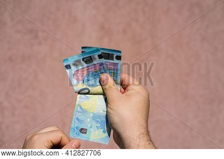 Hand Couting Holding And Showing Euro Money Or Giving Money. World Money Concept, 20 Euro Banknotes