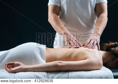 Side View Of Naked Young Woman With Perfect Skin Getting Professional Relaxing Massage At Spa Salon.
