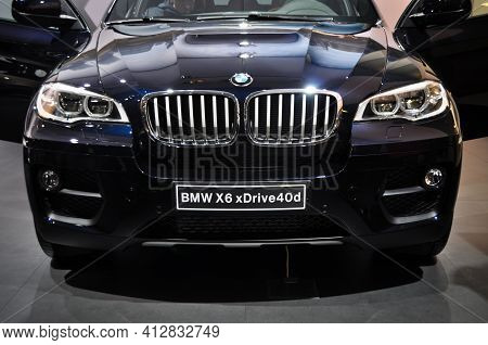 Front View Of Luxury And Bmw X6 Under Lights In Showroom, November 02.2012 Istanbul Turkey Internati
