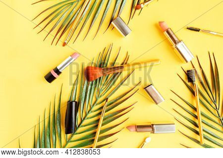 Set Of Pink Lipsticks And Makeup Brushes On Bright Yellow Background Flat Lay Top View Minimal. Beau
