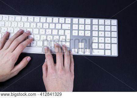 Female Hands On The White Keyboard On Black Baground. Typing, Writing, Freelance And Working From Ho