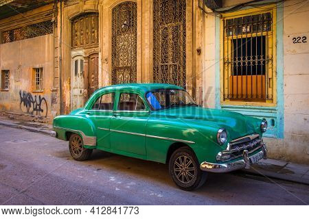 Havana, Cuba, July 2019, View Of A Green Old Classic American Car Parked In The Oldest Part Of The C