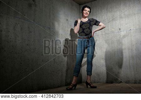 Beautiful Dancer Posing In A Corner Indoors