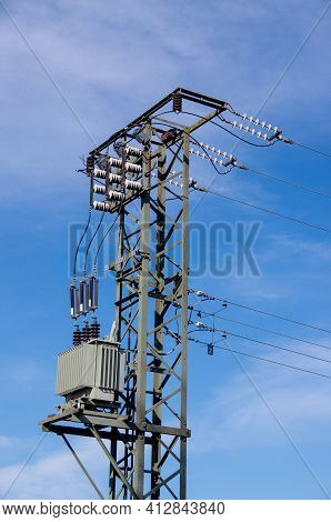 Electricity Mast With Transformers In Front Of Blue Blue Sky. High Quality Photo