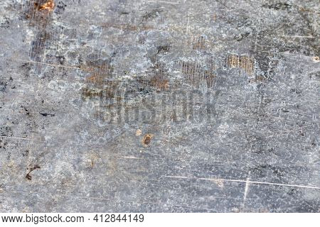 Background. Old Gray Metal Wall With Weathered Paint, Scratches And Rust.
