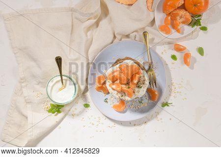 Pancakes With Yogurt And Tangerines