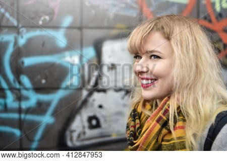 Blonde Urban Teen Girl Against Grafitti Wall. Street Style