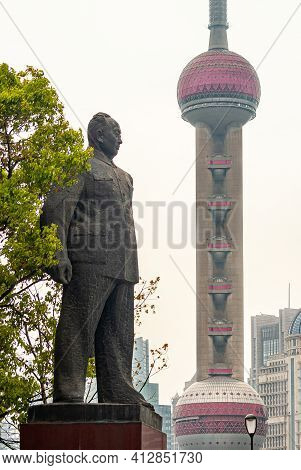 Shanghai, China - May 4, 2010: Massive Gray Statue On Red Pedestal Of Chen Yi, First Mayor With Gree