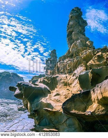 Blue Sky Above Scenic Coastal Rock Formation In Australia