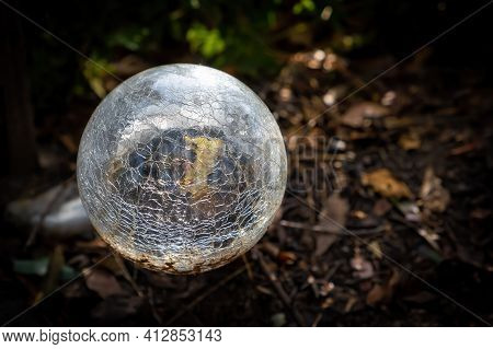 Garden Light Sphere Broken Glass On Blurred Background With Copy Space