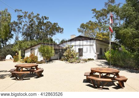 LAKE FOREST, CA - APRIL 14, 2017: Serrano Adobe and picnic area at Heritage Hill Historical Park. The adobe was built in 1863 on land then called, Rancho Canada de los Alisos.