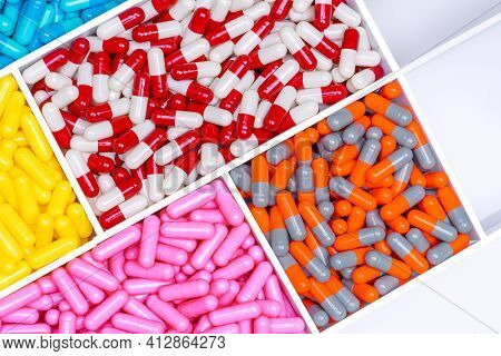 Top View Of Antibiotic Capsule Pills In Plastic Drug Tray. Antibiotic Resistance Concept. Antibiotic