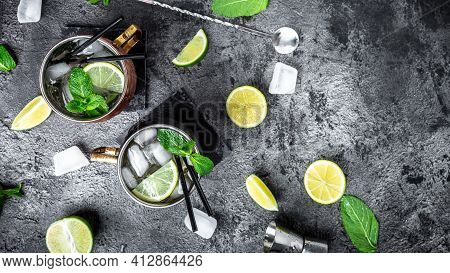 Two Moscow Mules Cocktail With Ginger Beer, Vodka, Lime. Long Banner Format, Top View.