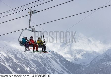 Whistler, British Columbia, Canada - March 10, 2021: People Going Up The Mountain On A Chairlift Wit