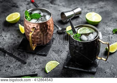 Two Icy Cold Moscow Mules Cocktail With Ginger Beer, Vodka, Lime. Banner, Menu Recipe, Top View.