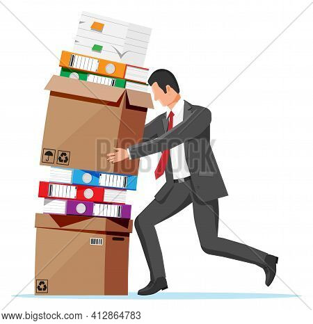 Stressed Businessman Pushing Pile Of Office Documents. Overworked Business Man With Stacks Of Papers