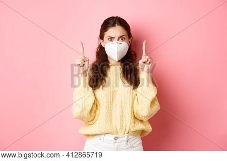 Covid, Corona And Social Distancing Concept. Confused And Shocked Young Woman In Medical Respirator