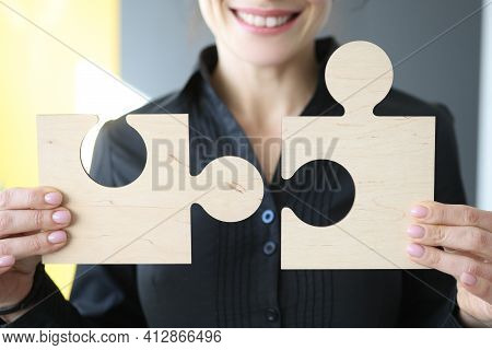 Woman Holding Wooden Puzzle Details In Her Hands Closeup