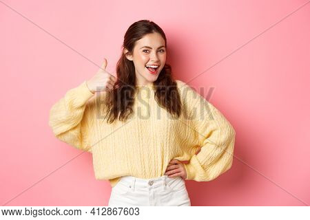 Portrait Of Beautiful Brunette Female Model Showing Thumbs Up, Like Your Idea, Give Support, Approve
