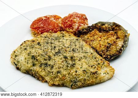 Baked Halibut Fillet With Baked Stuffed Pepper And Stuffed Tomatoes.