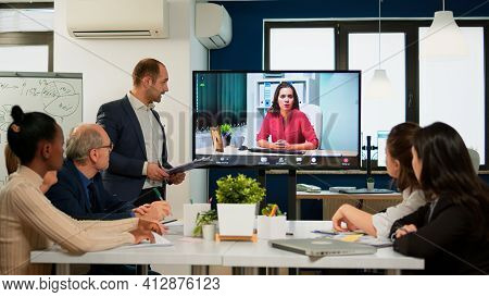 Project Manager Presenting Company Ceo Discussing On At Webcam During Virtual Business Presentation.