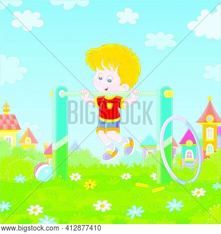 Cheerful Little Boy In Light And Colorful Sport Clothes Pulling Himself Up On A Sport Horizontal Bar