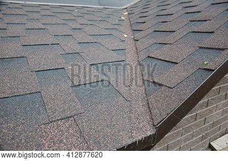 Asphalt Shingled Roof Inspection: A Roof Valley Flashing On An Asphalt Shingled Waterproofing Roofin