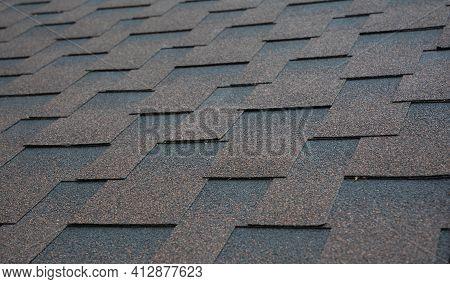 Architectural, Dimensional Asphalt Shingles Roofing Material Background.  Brown, Copper Asphalt Shin