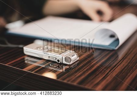 Shallow Depth Of Field (selective Focus) Image With An Audio Recorder Of A Woman Journalist During A