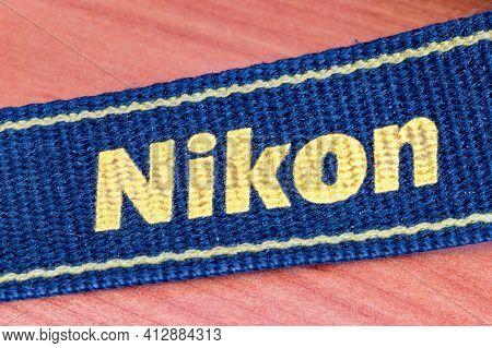 Pruszcz Gdanski, Poland - March 16, 2021: Nikon Sign On Strap Of Dslr.