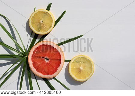Summer Exotic Tropical Fruits Background. Flat Lay Composition With Slices Of Red Grapefruit, Lemon,
