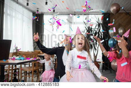 Cheerful And Laughing Schoolgirl Girl Cheerfully Rejoices. Birthday Celebration Concept. Cheerful Fa