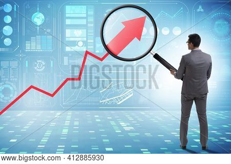 Concept of economic growth with chart and magnifying glass