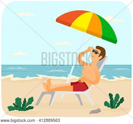 Smiling Guy Is Sitting In Sun Lounger Under Umbrella And Tanning. Man Is Sunbathing At Resort
