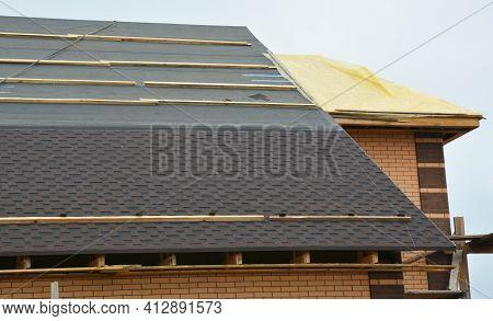 How To Install Asphalt Roof Shingles: A Close-up Of Asphalt Shingles Installation On The Roof Covere