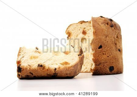 Christmas food - Panettone and slice on a white background.