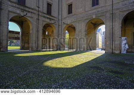 December 2020 Parma, Italy: Courtyard Of The The Palazzo Della Pilotta With Heads Exhibition.view Fr